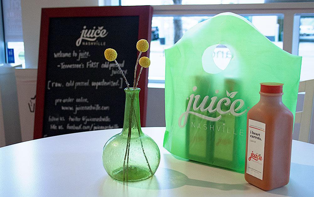 A custom-printed bag at Juice Nashville