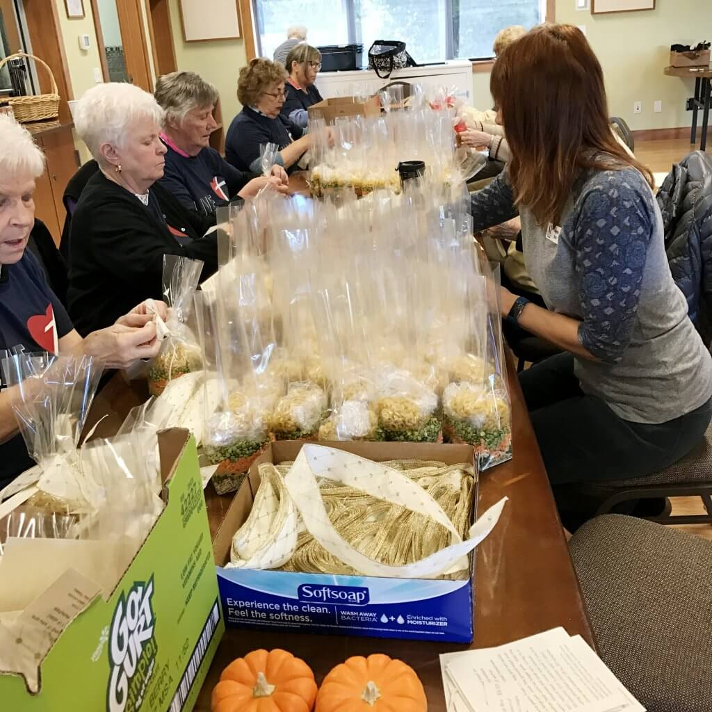 Assistance League Bellingham volunteers assemble soup mixes to sell for charity