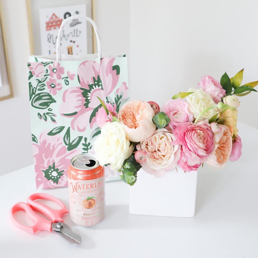 Petals & Pop floral arrangement with Nashville Wraps packaging